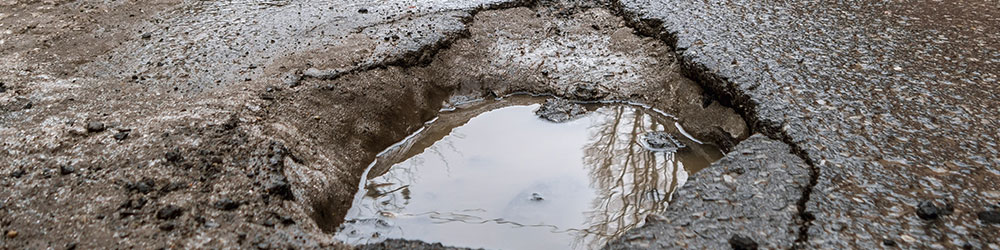 How to Avoid & Prevent Pothole Damage to Your Vehicle, Youngs Insurance, Ontario
