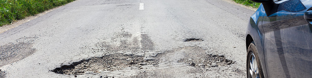How to Know if There's Damage to Your Vehicle After Hitting a Pothole, Youngs Insurance, Ontario